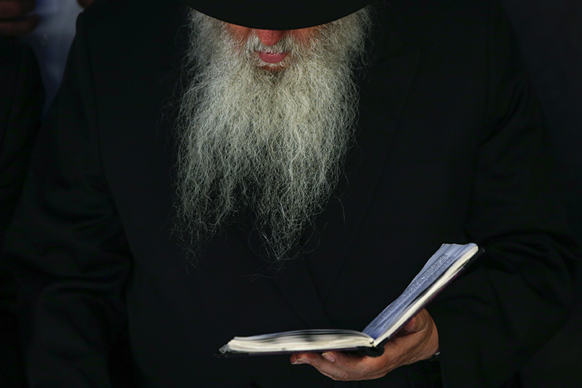 <p>A visitor prays at the gravesite of the Lubavitcher Rebbe, Rabbi Menachem Mendel Schneerson, at the Old Montefiore Cemetery in the Queens borough of New York June 30, 2014. Monday evening and all day Tuesday mark the 20th anniversary of the Rebbe's passing with organizers estimating 50,000 visitors to the site in tribute to the late Jewish leader.  REUTERS/Shannon Stapleton (UNITED STATES )</p>