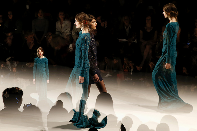 <p>Models present creations from the Tadashi Shoji Fall 2014 collection during New York Fashion Week February 6, 2014. Picture taken using multiple exposure. REUTERS/Shannon Stapleton  (UNITED STATES )</p>
