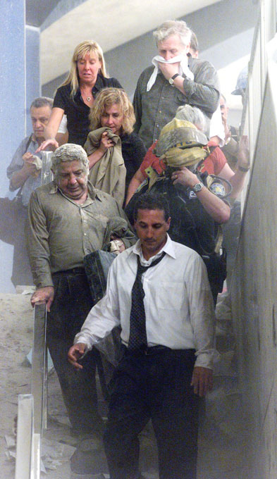 People evacuate down the stairs of the North Tower on the morning of September 11, 2001.