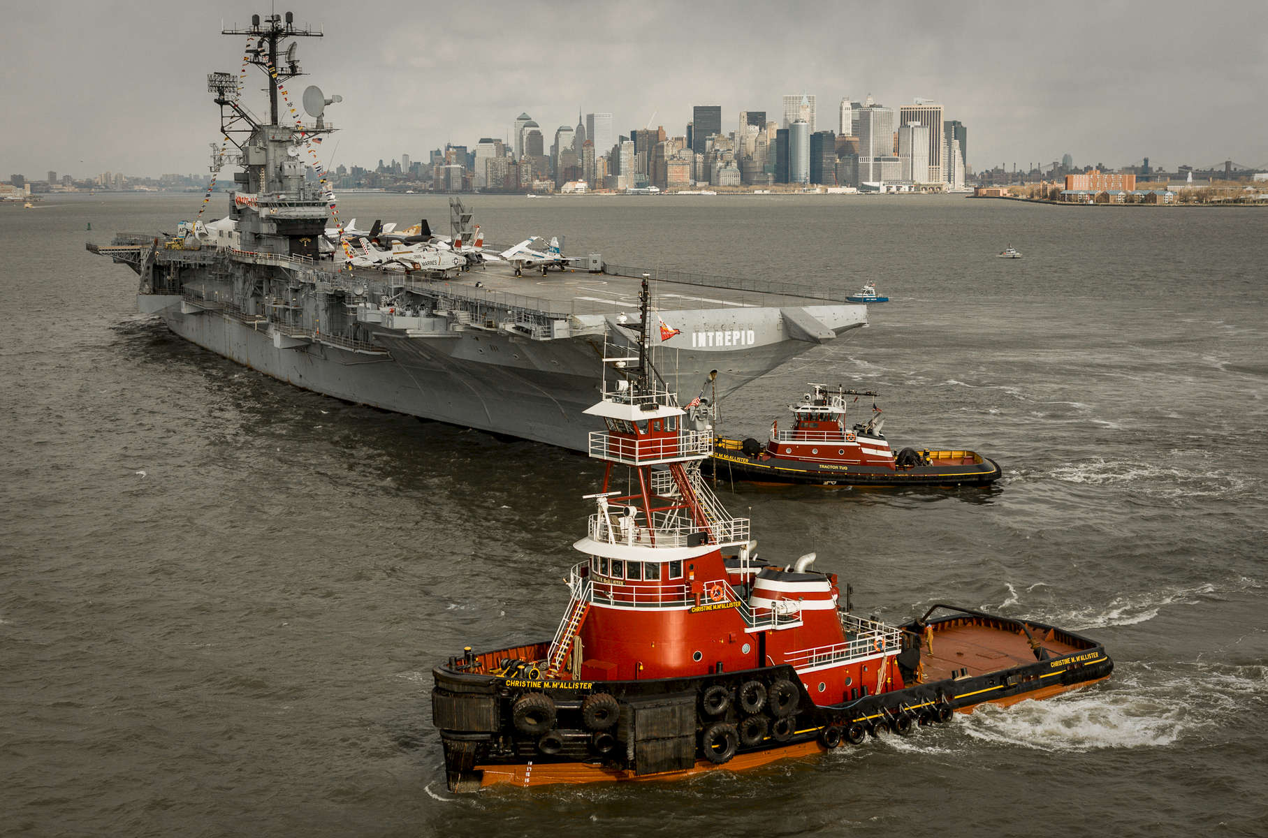 McAllister Towing pulls aircraft carrier Intrepid from Manhattan to Bayonne. Photographs show 2nd and successful attempt to move Intrepid from NYC west side manhattan to Bayonne.  First Attempt was November 6, 2006 on the full moon.