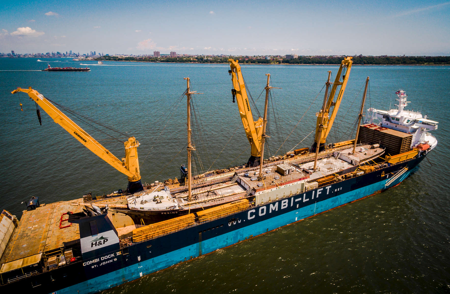 Tall Ship Peking, formerly owned by South Street Seaport Museum, NYC has been sold to the Hamburg Maritim Foundation.  Sails to Hamburg aboard the heavy lift semi-submersible vessel COMBI-DOCK III, owned by Combi-Lift.  Peking is 377 foot long, built from rivieted steel in 1911.  Masts 170'. Photo by Jonathan Atkin with professional drone.