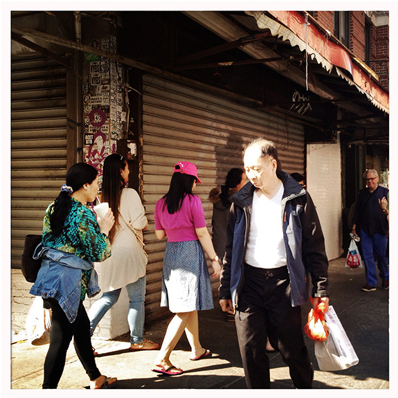 A scene on Mott Street north of Canal, a neighborhood that was historically considered Little Italy. New York's ethnic Chinese demographic continues to grow, to just over half a million residents in 2011, or 6% of the city's overall population. But many younger Chinese-American families have been moving away from Chinatown to the outer boroughs or suburbs, leaving behind a life of cramped tenements. Instead, the neighborhood is seeing an influx of single-person households and white residents, the usual harbingers of gentrification. Almost three-quarters of Chinese New Yorkers are foreign born, i.e. first generation immigrants. In the last few decades, narratives of the Asian immigrant striver have taken hold in the media and popular imagination, and the myth of the model minority is obscuring much more diverse lived experiences and complex realities. Especially among older Chinese New Yorkers, many are struggling with being linguistically isolated from the English-speaking culture they are surrounded by, and poverty levels are significantly higher than among the rest of the city's seniors (at 30.5 percent for people over age 65, vs. 18.2 percent of the general population.)