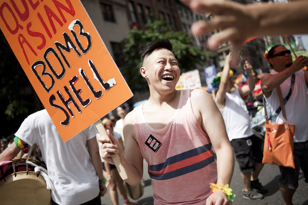 Members of GAPIMNY and Q-Wave groups for queer Asian American New Yorkers march in the Gay Pride Parade.