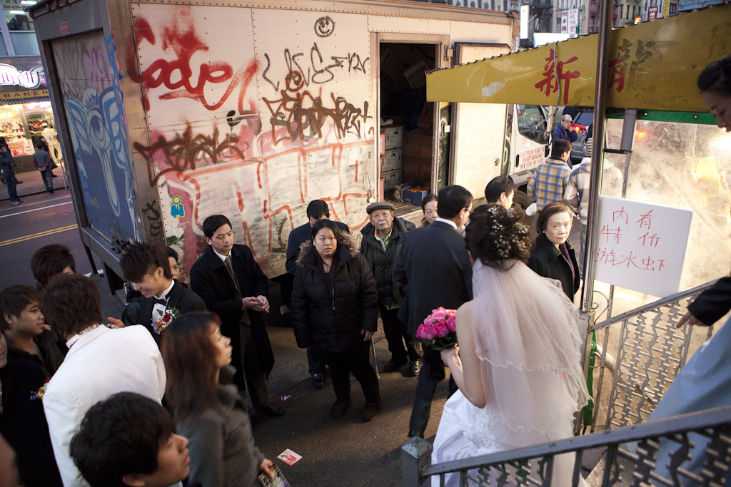 A bride is leaving an East Broadway beauty parlor ahead of her Thanksgiving wedding.