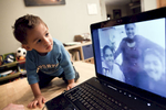 Blaze meets his unborn twin siblings' surrogate (at left) during a skype chat.
