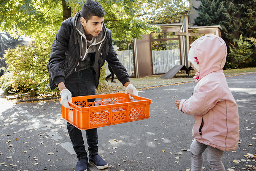 "Abdullah, a 17-year-old Palestinian youth, grew up in Yarmouk refugee camp in Damascus, which saw heavy fighting during the Syrian civil war. He came to Berlin with his 18 y.o. sister in the summer of 2015, a time when the LAGeSo processing center had become unable to cope with the increasing numbers of newly arriving refugees. A week into the wait for his number to come up, which in the end would take 45 days, Abdullah encountered Moabit Hilft, a local community organization that has been instrumental in  providing shelter, clothing and medical care to people stranded at LAGeSo.  Ever since, House R, the organization's bustling headquarters, has served as his Berlin focal point. ""I was thinking that these are nice people. Others don't do the type of things they are doing."" He is volunteering with the group daily, and is making friends among the Berlin old timers, but also the many young refugees (50% of all volunteers by one estimate) who have become a crucial part of keeping Moabit Hilft running. At the same time, Abdullah's cheerfulness masks his growing frustration at being stuck in limbo: his Termin (appointment) to officially register as a refugee isn't scheduled until mid-January, and he won't be able to attend school before receiving his papers."
