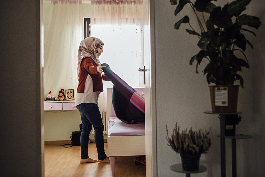 "Aseel tidies her bedroom. Since June, aft, er months of separation and a year spent in refugee housingher family has been reunited in their own apartment on the southern outskirts of Berlin . They painstakingly renovated their new home – Aseel picked out wallpaper decorations and bought the furniture on eBay: ""I'm learning online, as well, because I want to learn how to speak German more quickly.""