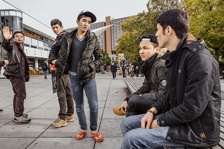 Omid and a friend meet up with a group of young Afghans at Alexanderplatz. Official figures have tracked an estimated backlog of more than 1,500 unaccompanied minors who are temporarily placed in hostels and other emergency housing throughout Berlin, mixed in with an adult refugee population and with limited youth services or supervision available. Insiders working with the Berlin Senate's youth agency report that future intake appointments to be officially registered by the youth welfare services have now stretched into the end of the 2016 calendar year.  Data compiled by Germany's Federal Office for Migration and Refugees show that between 2009 and 2013, the number of unaccompanied minors from Afghanistan by far surpassed those from other source countries. In 2014, as well, the largest group of unaccompanied minors claiming asylum in European countries hailed from Afghanistan, at 6,155 refugee youths under age 18 out of a total of 24,000.