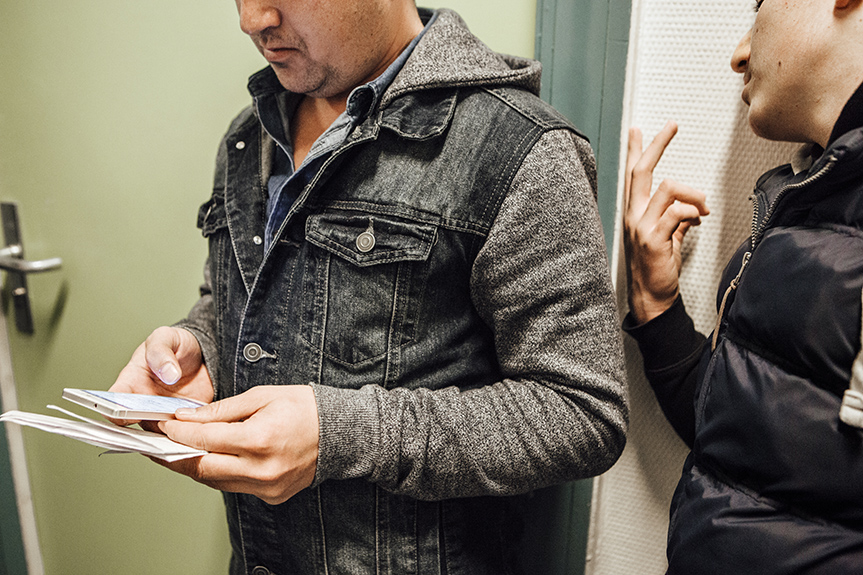 Adel (left) is trying to register his younger cousin Younis, 15, by using the address of the Berlin hotel where they have found shelter. The Yazidi boy had finished sixth grade in Iraq before he had to flee the war, and hopes to re-enroll in school. Younis and Adel are joining a large community of Yazidis who are seeking refuge in Germany, a high percentage of whom are being granted asylum as a persecuted minority. But there are complications: Adel had been fingerprinted in the Czech Republic when entering the EU, Younis was not. Their lawyer is arguing that separating them by sending Adel to the Czech Republic under Dublin III regulations would constitute a hardship for the teen, but since he has been placed under his relative's custody, he no longer enjoys special protections as an unaccompanied minor refugee.