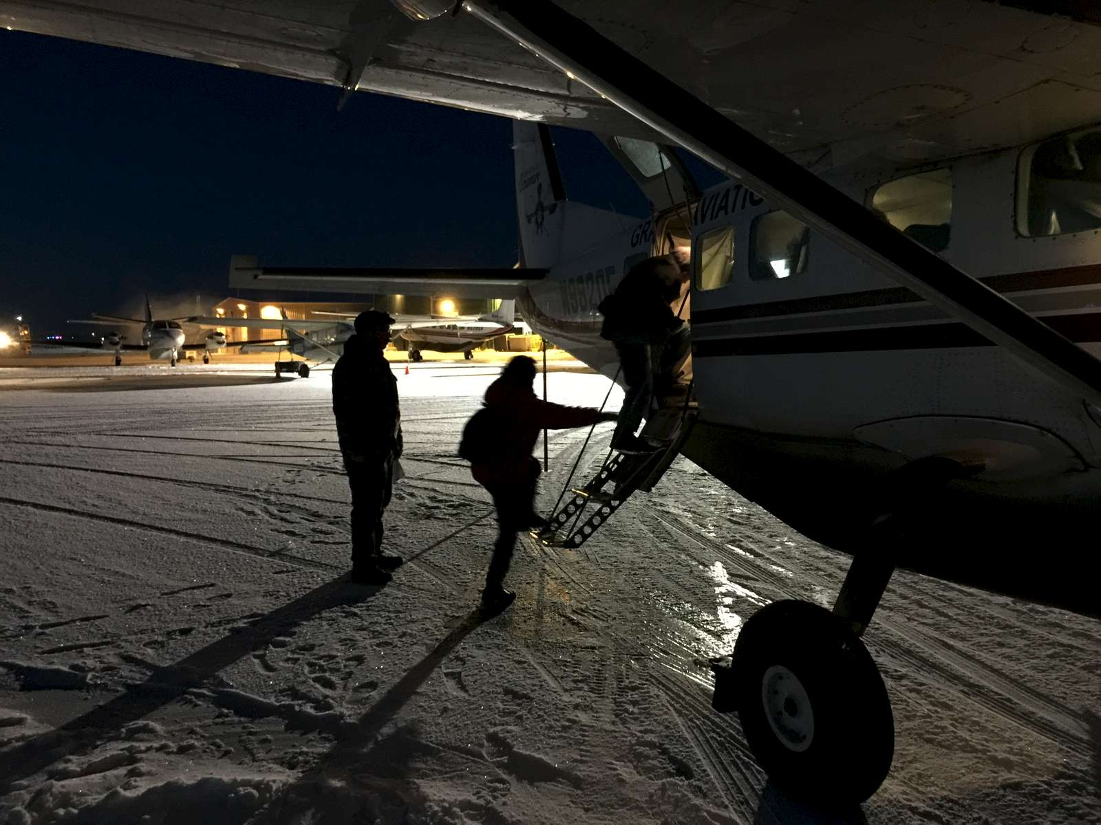 Members of the Calricaraq trauma response team board a 9 person plane to visit a family in the village.