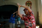 Neal Warrington, Menominee, participates in an exercise program at the Chicago Indian Center. He road a bus to Chicago from the reservation in Wisconsin in the 1960's. He had no contacts, money or information and ended up walking from the bus depot downtown to Irving Park on the northside, over 7 miles. He asked people along the way where the Indians lived. {quote}It was very exciting, {quote} he recalls.