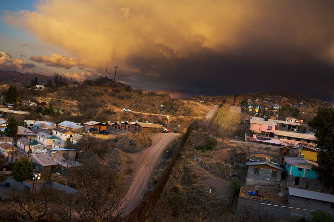 This stretch of the border divides Nogales, Arizona at left and Nogales, Sonora at right.  There has been little violent spillover into the US, though recently US citizens have been killed with more frequency in Mexico.  In March of 2010, two US Consulate workers were gunned down in Ciudad Juarez.
