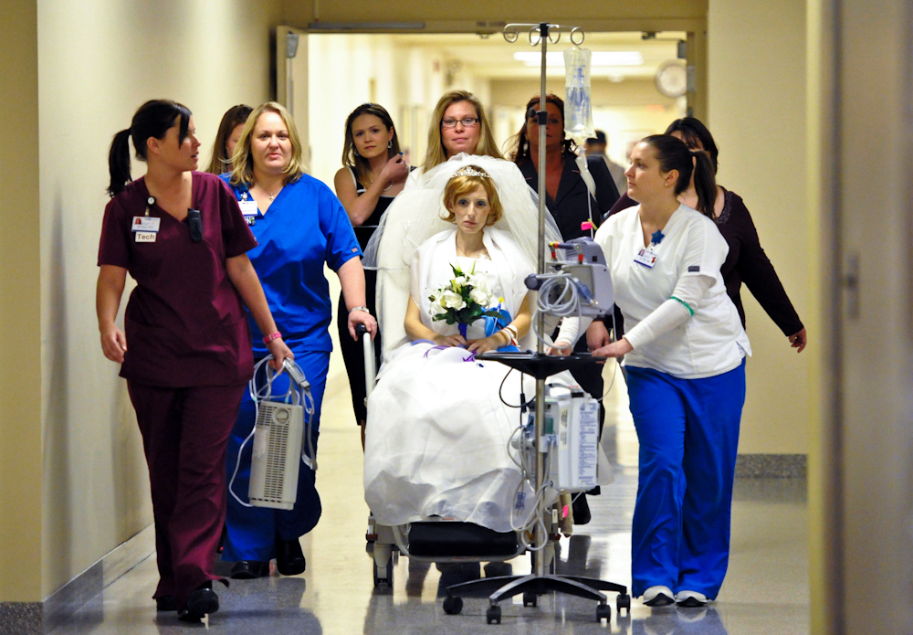 Jessica Wirth is tended to by the St. Mary's Medical Center staff as she makes her way to the chapel for a commitment ceremony to Daniel Lawrence, her partner of seven years, at St. Mary's Medical Center in Evansville on Thursday, January 13, 2011. Wirth had surgery on Wednesday and has advanced gastric cancer. With the help of family, friends and the staff at St. Mary's, the ceremony was put together in under twenty-four hours. Only two days later on Saturday January, 15, 2011, Jessica passed away at 7:35 p.m. surrounded by her family and friends.  The couple has a son, Colton, 18 months.
