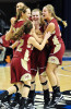 Ashlynn Spahn, front left, Tori Schickel, left center, Brianna Dickerson, back left, and Casey Jochem, right, surround Maura Muensterman, center, after she made the game winning shot in overtime against Fort Wayne Bishop Luers in the 2A girls' state championship basketball game at the Hulman Center in Terre Haute, on Saturday, March 3, 2012.  Muensterman's shot left 0.2 seconds on the clock. Bishop Luers then called a time out when they had no timeouts remaining, resulting in a two-shot technical foul. Muensterman made the two free throws to end the game with a final score of 56-52.