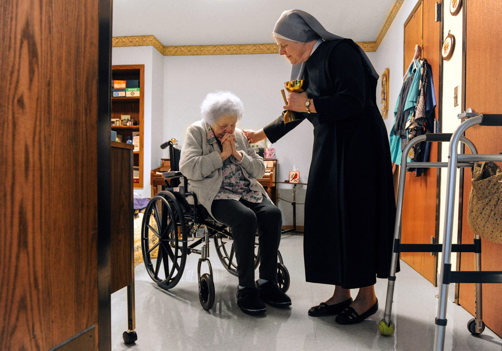 "Bea Belcher receives communion from Sister Carolyn Martin recently at St. John's Home for the Aged, which is run by Little Sisters of the Poor, in Evansville. Belcher, who started in the independent living apartments in 1987, has been at the facility for 25 years. ""They've always been so good to me here,"" she said. Last spring the Little Sisters announced that they planned to withdraw from operating the home once they found a suitable sponsor to take over. They are still searching and continue to seek financial donations for the home."