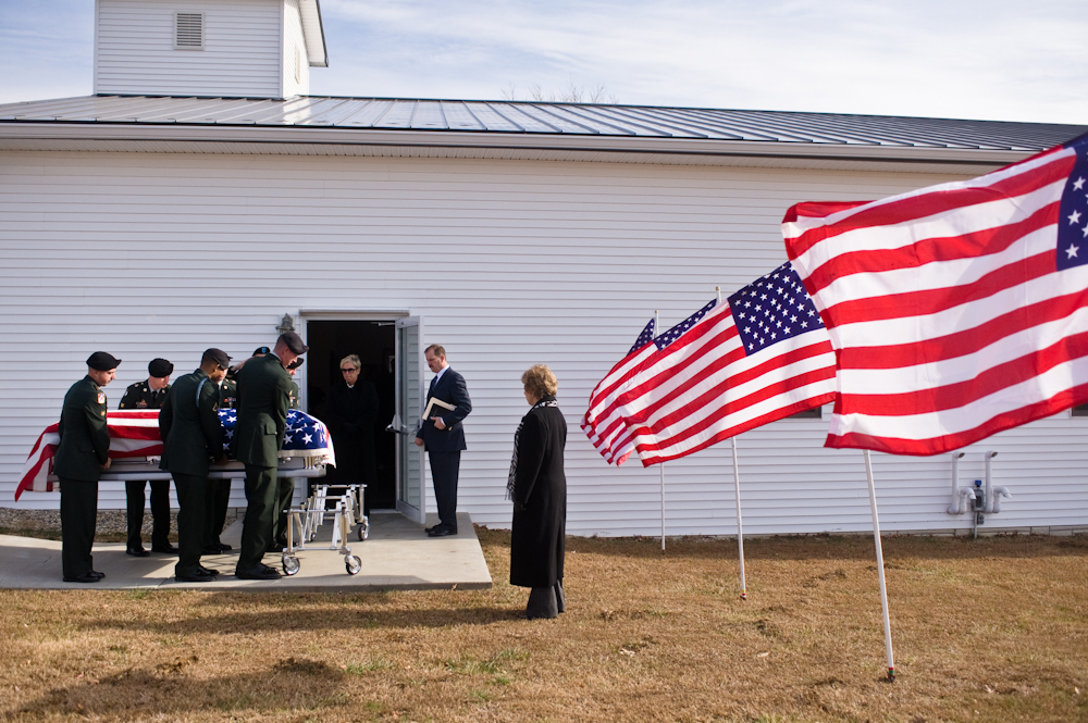 The casket of Army Sgt. Barry Jarvis, 36, is brought into Deer Creek Baptist Church in Tell City, Ind.