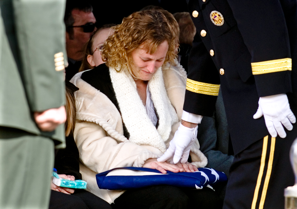 Tina Jarvis, the widow of Army Sgt. 1st Class Barry E. Jarvis, accepts a flag from Brig. Gen. William {quote}Tim{quote} Crosby at the Deer Creek Baptist Church Cemetery in Tell City, Ind., Thursday. Barry Jarvis was a member of the 101st Airborne Division in Fort Campbell, Ky.