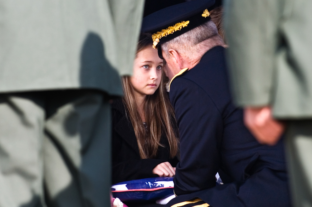 Brig. Gen. William {quote}Tim{quote} Crosby presents a flag to Kitaira Jarvis, 11, daughter of Army Sgt. Barry Jarvis, 36, at Deer Creek Baptist Church in Tell City, Indiana on Thursday, Dec. 9, 2010. Jarvis, a member of the 101st Airborne Division in Ft. Campbell, Kentucky, was one of six soldiers killed on Nov. 29 in Afghanistan when a rogue Afghan border policeman turned his gun on his American trainers as the group headed to shooting practice.