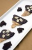 Chocolate covered butter toffee with almonds by Aimee Blume.