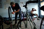 Chuck Blumberg fixes his bike in the waiting area of SouthEast Staffing while his friend, Blake Harris, waits for him to finish.  Both men live on their own in the woods and depend on their bikes like most people depend on their cars.