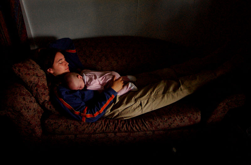 Monica Trullinger takes a nap with her baby, Zelda Melton, 5 months, on the couch at the apartment she shares with her boyfriend, Tony Melton, in Vero Beach.  In 2001, at age 24, Trullinger was dissatisfied with her life in Seattle, Wa.,  and decided that she wanted to try being homeless. {quote}I thought it was kind of fascinating.  I wondered what their day to day life was like.{quote} said Trullinger.  But she always knew she did not want to be homeless forever.  {quote}It was a lot harder to get out (of being homeless) than I thought,{quote} said Trullinger.  {quote}I'm not homeless anymore but I'm still in poverty,{quote} said Trullinger.  {quote}And I don't want to raise a child in poverty.{quote}