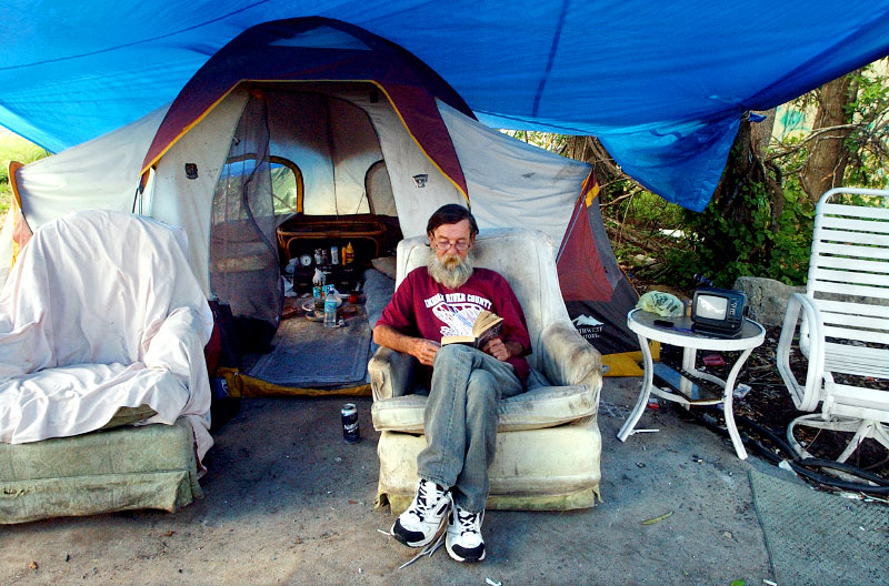 Donald G. Lanier, known in the homeless community as Papa Smurf, spends most of his days relaxing in his camp, reading and drinking.  Lanier shares his camp with several other people.  However, many of the homeless like to camp alone to avoid interpersonal conflicts.