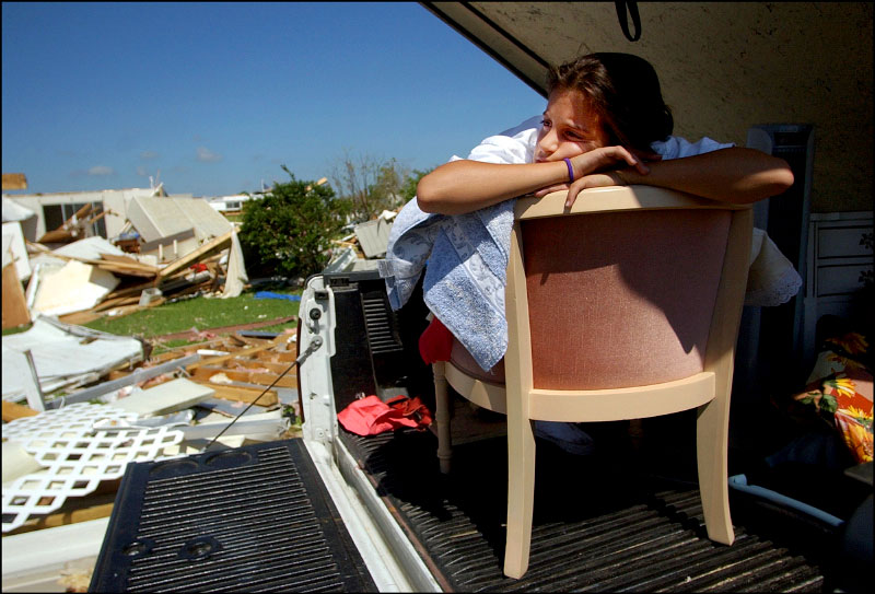 Lauren Breinlinger, 12, takes a rest from helping her 90 year old great-grandmother, Anne Lapardo, move out of her condemned manufactured home in Barefoot Bay on Tuesday, September 28, 2004.  Breinlinger and many of her family members had been working all day removing furniture and family heirlooms.