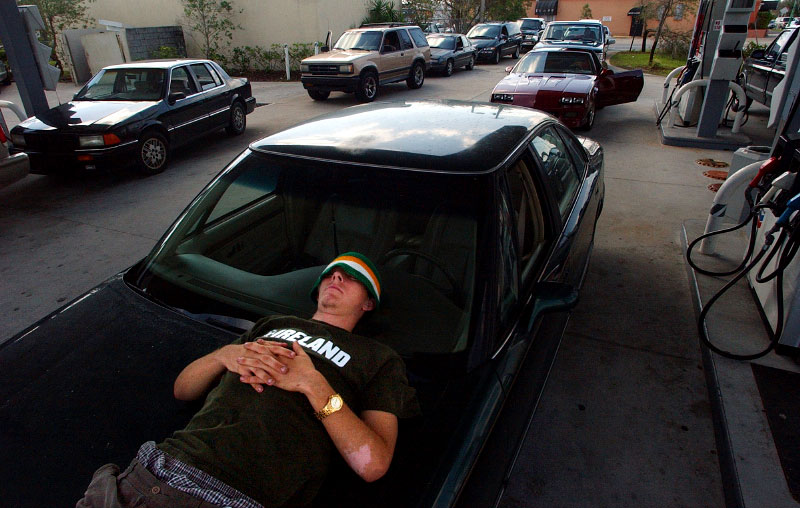 Andy Blossom, 18, of Sebastianm Fla, naps on his car while waiting for the power to be turned on at the Chevron gas station at 2602 U.S. 1 in Vero Beach on Monday, September 27, 2004.  Customers waited several hours, hoping that the power would be turned on.   The station's manager, George Deep, said they had gas for 600-700 cars but had no way to pump it.  Blossom was one of the first ones it line and didn't plan on leaving.  {quote}I'm runnin' on fumes so I can't go anywhere,{quote} said Blossom.