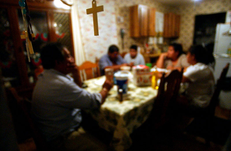 The night before leaving on a 24-hour long road-trip to Monterrey, Mexico,  Ramiro Solis and his family gather around their kitchen table in Fellsmere to iron out the final details of the trip.  The family usually travels to Mexico twice a year to visit relatives but this year four car loads of family members traveled to Monterrey to help Ramiro's youngest daughter, Evelia, make the preparations for her quinceanera.