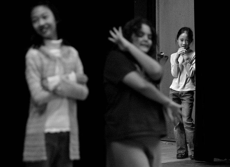 Isabel Lu, 9, right, watches as her sister, Katherine Lu, 11, left, and Katherine Minor, 10, center, perform during the movement part of their audition for {quote}Charlie and the Chocolate Factory{quote} at the Greensboro Cultural Center on  January 6, 2007.