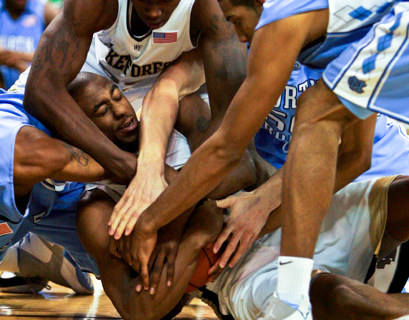 L.D. Williams of Wake Forest, center, gains control after a loose ball in the game against  North Carolina at Lawrence Joel Coliseum in Winston-Salem on Wednesday, January 24, 2007.  North Carolina won 88-60.