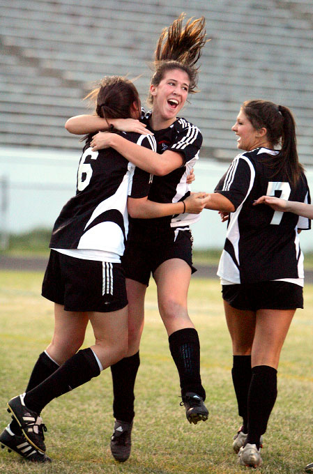 Frances Johnson, left, Leigh Rolandelli, center, and Ashton Lewis, right, of Northwest Guilford High School celebrate the first and only goal during the first half of their game against Grimsley High School in Greensboro on Tuesday, March 27, 2007. Northwest Guilford beat Grimsley 2-0.