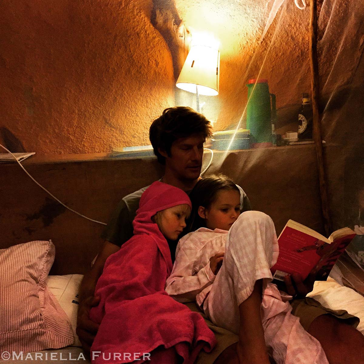Frank reading to Mayian and Selkie at bedtime