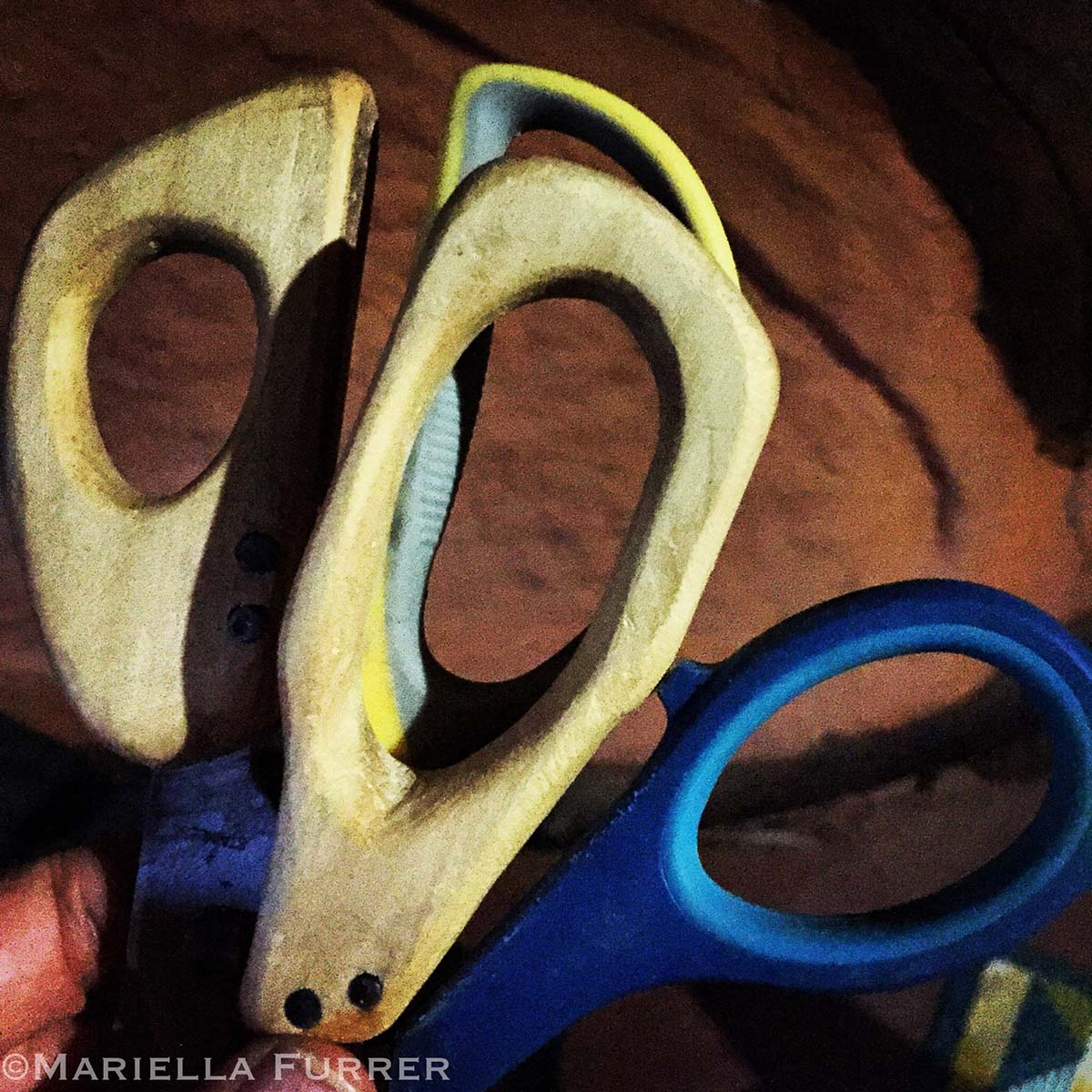 Instead of throwing away broken scissors, Saba gets a Turkana nomad to carve wooden handles for them.