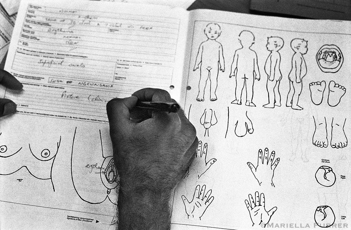 A doctor fills in a J88 form to document relevant medical findings for court purposes in cases of sexual or physical abuse. PLACE: Port ShepstoneDATE: November 2002