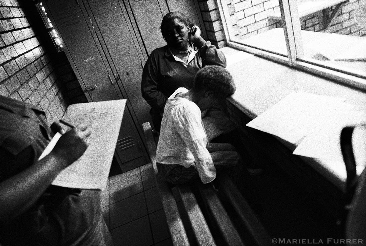 A girl, 8, who was sexually abused by her maternal uncle, 11, rests her head on the counter after giving her statement to police. The young boy admitted to playing sexual games with the girl and was enrolled in a diversion programme for young sex offenders. PLACE: Delft, Wesetern CapeDATE: March, 2004