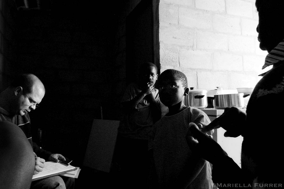 An 8-year-old boy gives a statement to Inspector Ian van Romburgh, a police child protection officer, about his sexual abuse, as three friends, victims of the same perpetrator, listen on. PLACE: Mfuleni, Western CapeDATE: July 2005