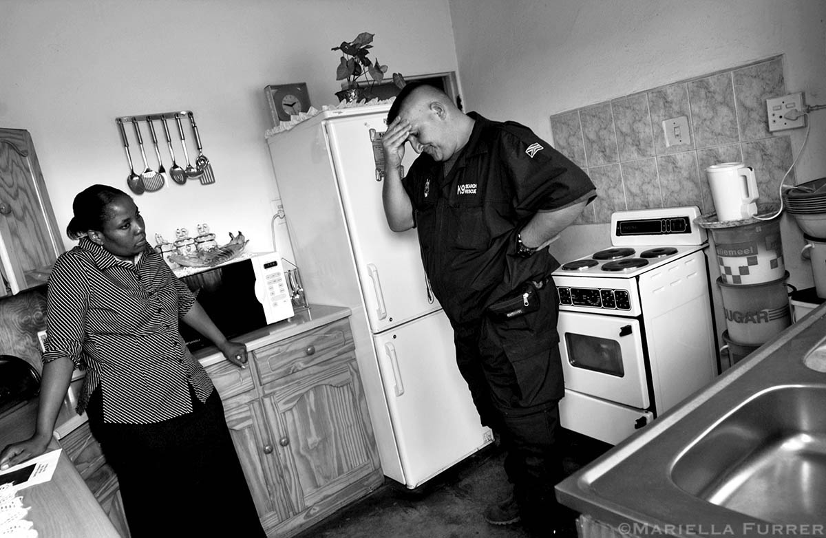 Inspector 'Stroppie' Grobbelaar struggles to tell Anna Lesele, the aunt and adoptive mother of Kamo, that his search team has still been unable to find her. Grobbelaar stops at her house every day with an update.PLACE: Eldorado Park, JohannesburgDATE: December 2005