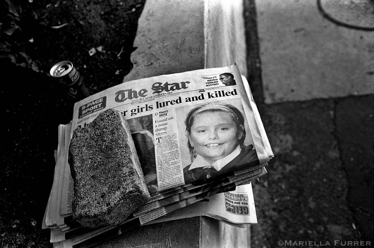 Newspaper headlines announce the sexual assault and murder of Tina Bernardes, 11, and the rape and murder of Sibongile Mokoena, 3. PLACE: Auckland Park, JohannesburgDATE: November 2003.