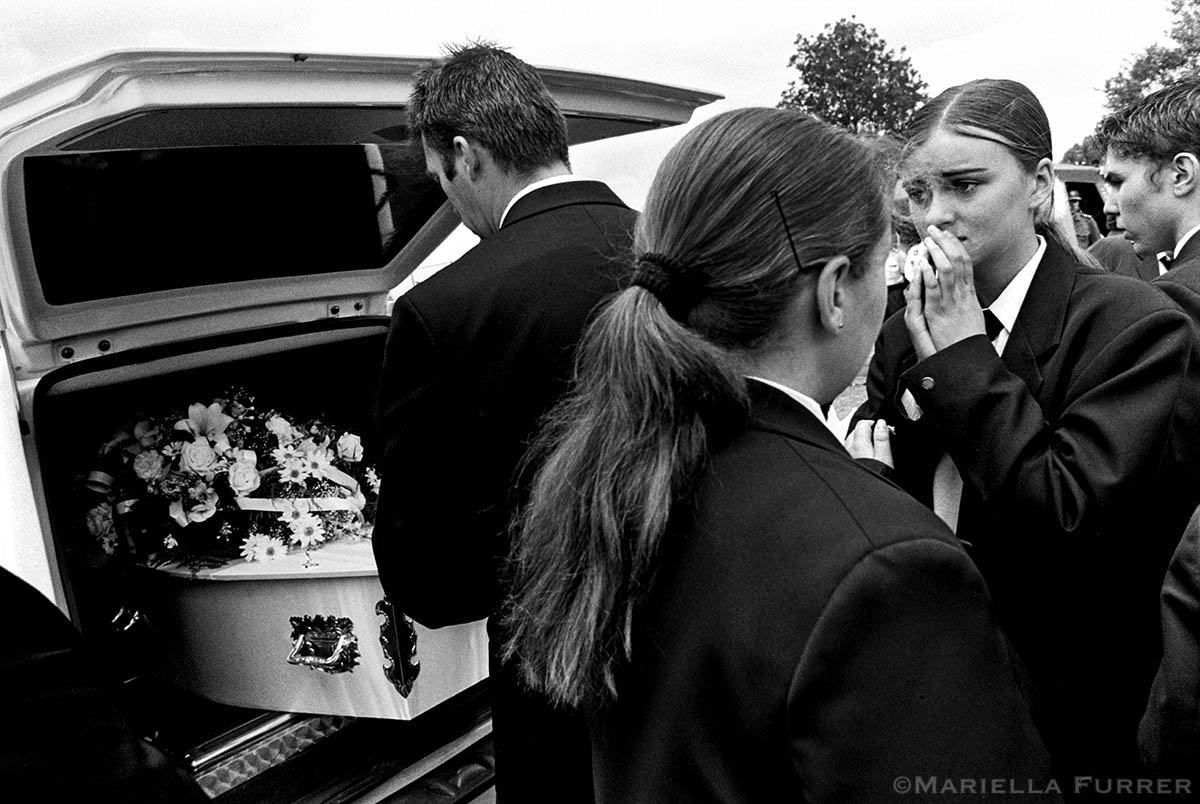 Funeral of Tina Bernardes, 11, the last victim in a series of sexually motivated crimes known as the {quote}Mine Dump Killings.{quote} Sipho Dube, 25, was given 10 life sentences for 7 murders and 3 rapes and the additional 114 years for a range of other crimes, including indecent assault and kidnapping. PLACE: Jeppestown, JohannesburgDATE: November 2003.