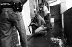 Task team members prepare to raid an apartment where they suspect children are being forced into prostitution. PLACE: JohannesburgDATE: November 2004