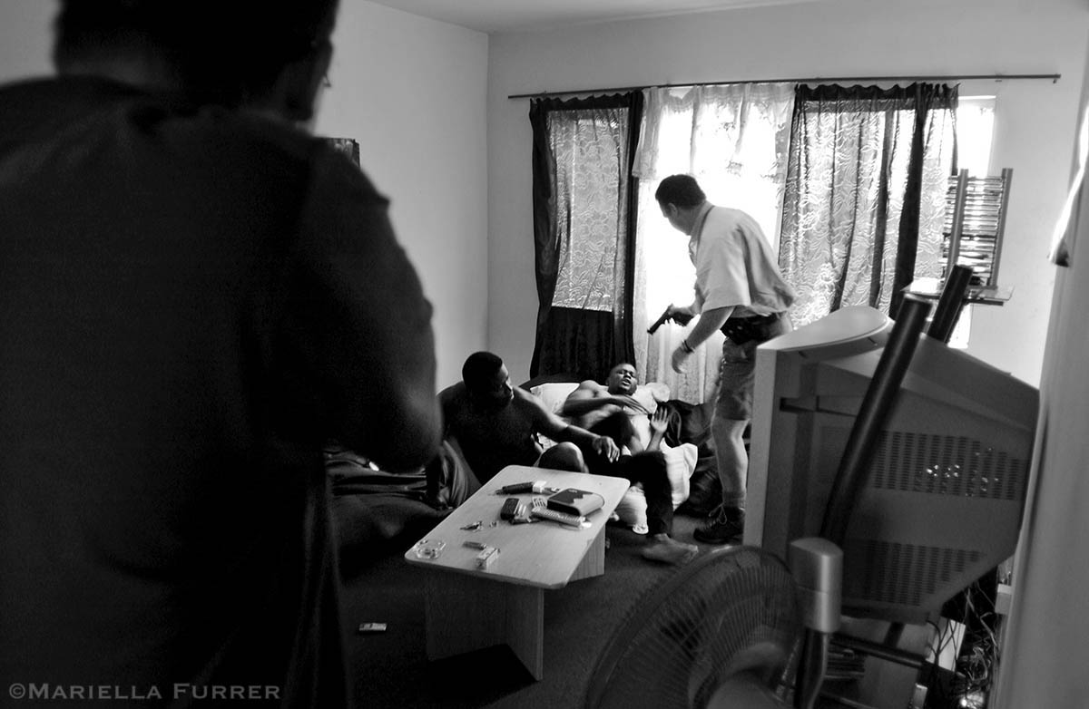 A task team raids an apartment suspected of housing children forced into prostitution. Police found crack cocaine, and arrested a Nigerian man for statutory rape. PLACE: DurbanDATE: January 2005