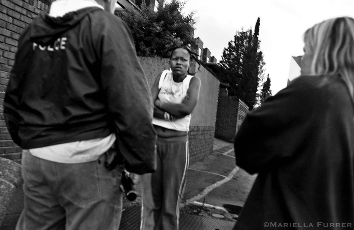 Police try to get information from Lerato, a girl suspected of coercing Jennifer into joining her on a bus ride from Durban to Johannesburg, and handing her over to her boyfriend, a pimp, to be forced into prostitution. She was later arrested for her role in the abduction. PLACE: GermistanDATE: December 2004