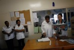 Nurses, Bernadette Rance, Sisana Maqoma, and healthcare workers discuss patients that had problems during the night before starting their morning rounds at the Sunshine Ward of the Jose Pearson TB hospital.  The Sunshine ward houses extremely-drug resistant (XDR) TB patients only.  The ward had 83 patients. Jose Pearson TB hospital