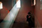 A shaft of light shines through the window of Rabbi Yaakov Abu Hatzeira's shrine where Jewish pilgrims pray.