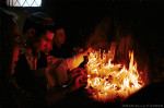 Jewish pilgrims light candles while praying in the shrine of Rabbi Abu Hatzeira.