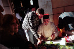 Jewish pilgrims get money and papers signed by the great-great grandson of Rabbi Abu Hatzeira at the Rabbi's Shrine.