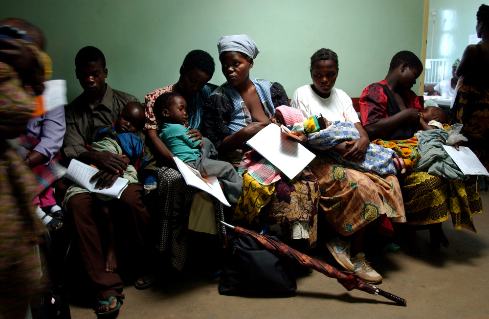 Parents wait with their children to be admitted to the pediatrics ward at the Lilongwe Central Hospital. May 2004