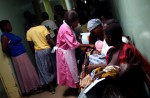 Agnes Masina, a student auxilliary nurse attends to children before they are admitted to the pediatrics ward at the Lilongwe Central Hospital. May 2004