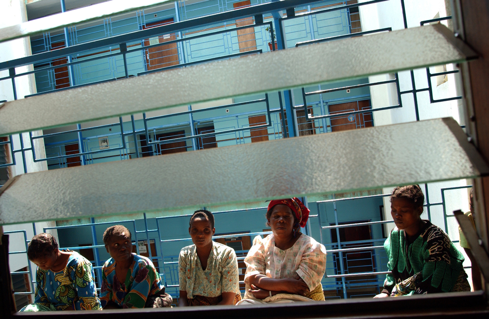Women sit outside the gynaecology ward at the Lilongwe Central Hospital. May 2004